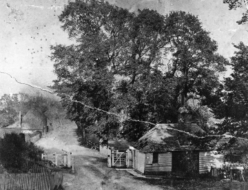 A 19th century photograph showing the toll cottage at Bramber