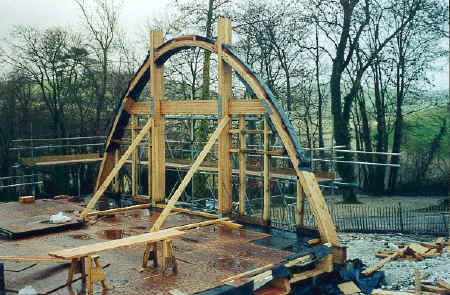 The first gable end is placed in position.