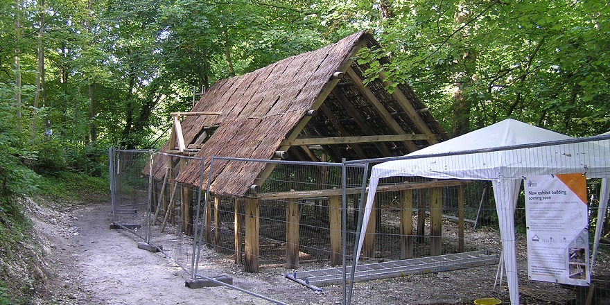 Woven hurdles applied to roof prior to thatching