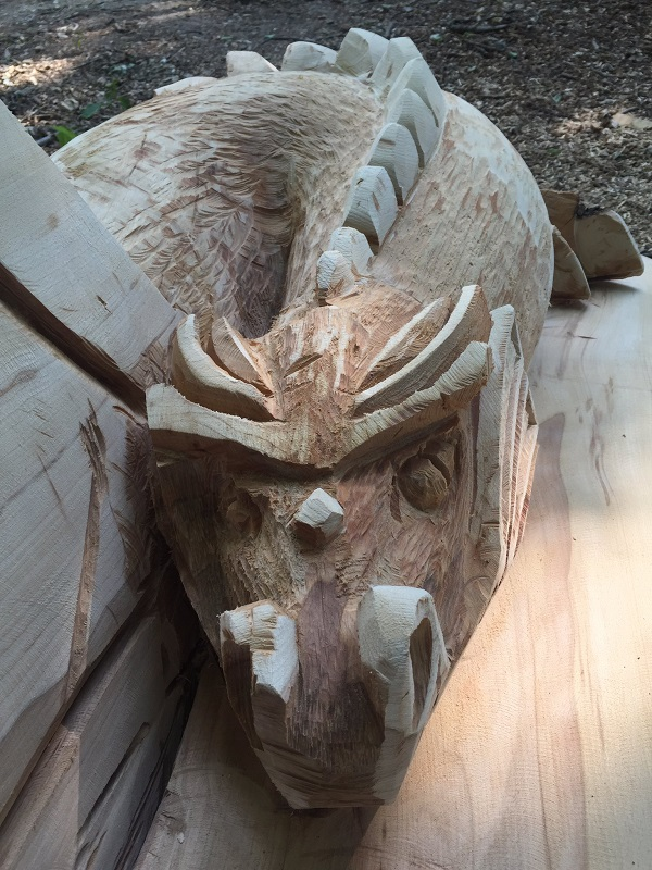 Dragon Knucker head carved into a bench