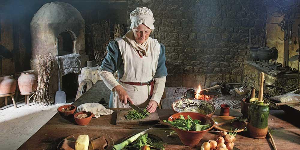 Madaleine preparing food in the Winkhurst Tudor kitchen