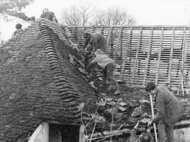 Volunteers stripping tiles from the Toll House 1968