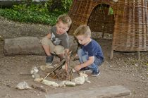 Boys playing outdoors at the Museum