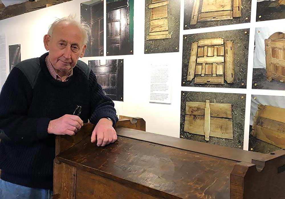 Craftsman Roger Champion with his furniture