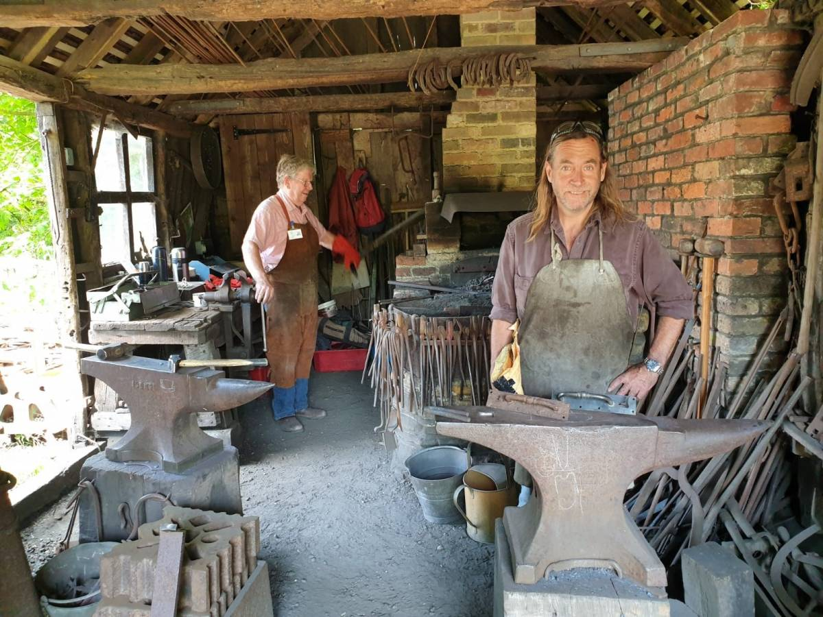 volunteers working in museum forge