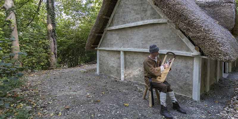 Saxon house construction: opening day musician in costume