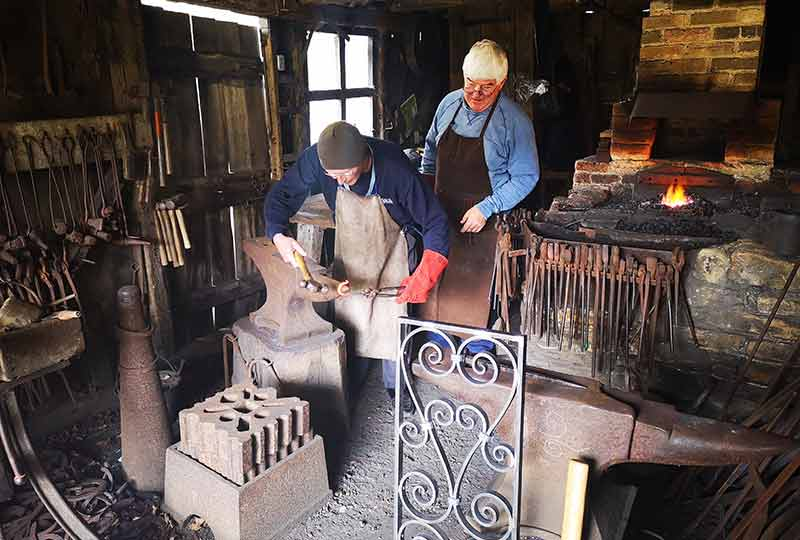 Smithies at work in the forge