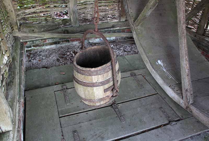 Treadwheel bucket and well