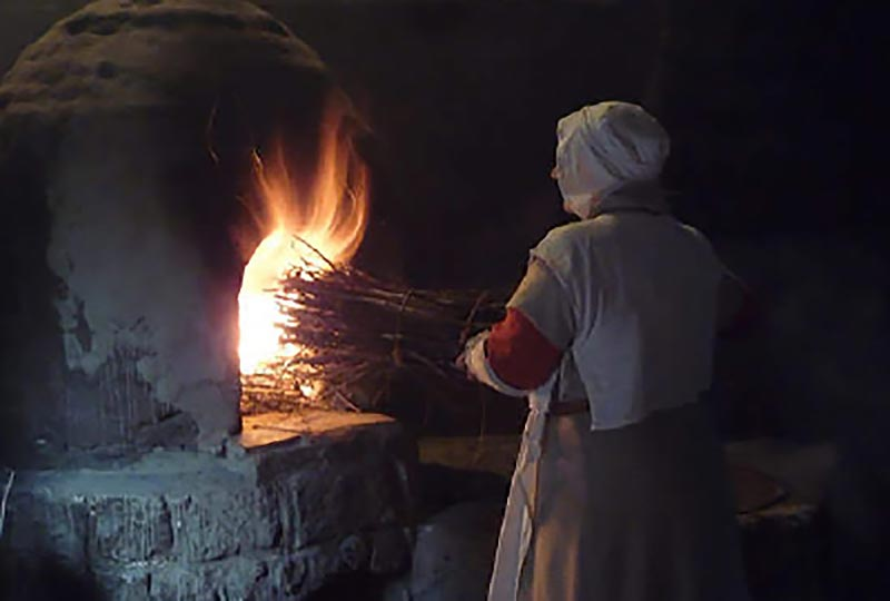 Fire-making craft demonstration at the Weald & Downland Museum