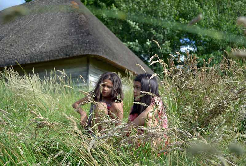 Girls sitting in long grass