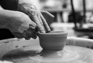 Throwing clay pottery
